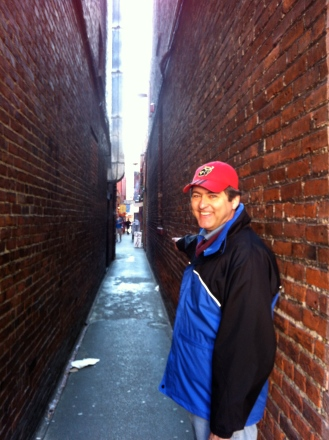 Michael pointing the way to an opium den in Fan Tan Alley in Victoria.