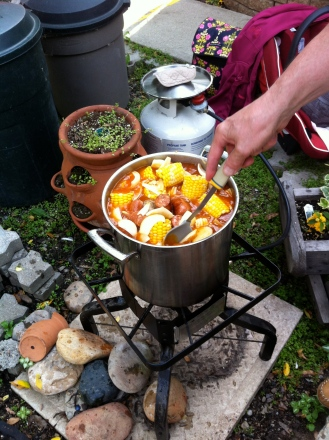 Shrimp boil with hand stirring pot.