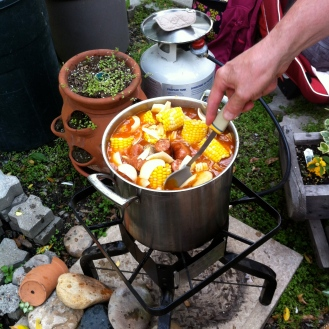 Shrimp boil with hand stirring pot.