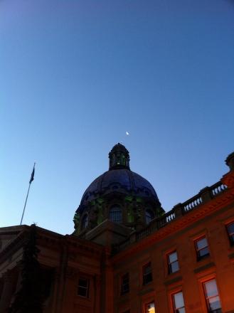 Moon over Legislature building.