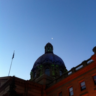 Moon over Legislature building.