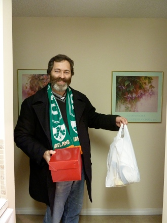 Michael in beard, Ireland scarf, red box and white bag