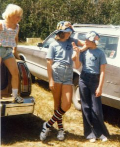 That's me with the striped socks. My sister is the one ready to leap off the back end of the station wagon.
